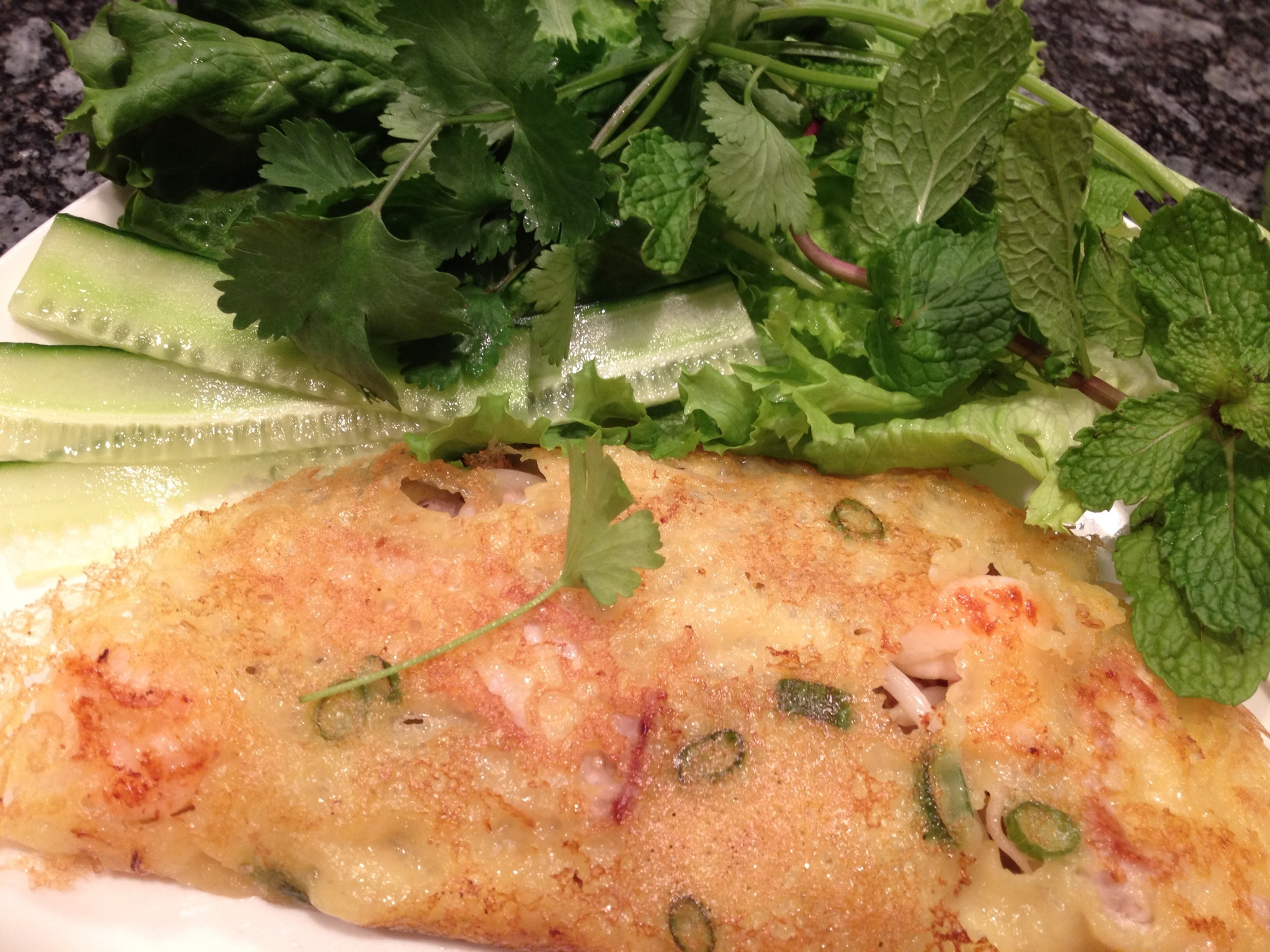 Banh xeo is a popular Vietnamese crispy, savory crepe filled with pork ...
